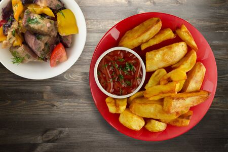 french fries with ketchup on a wooden background. french fries on a plate 写真素材