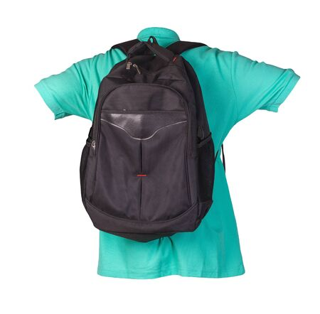 black backpack dressed for green t-shirt isolated on a white background. backpack and male sweater view from the back