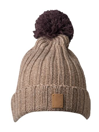 knitted biege hat isolated on white background.hat with brown pompon .