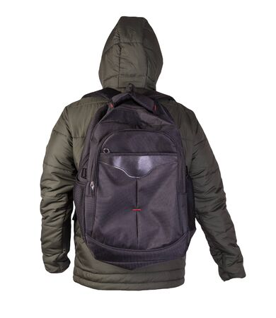 black backpack dressed in a hakki jacket isolated on a white background. rear view of a backpack and jacket