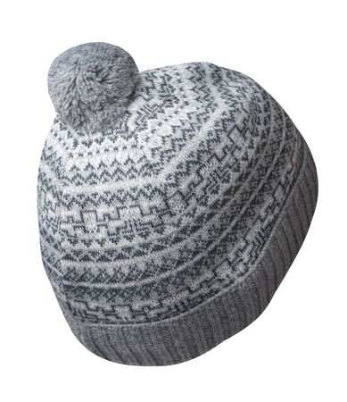 knitted dark grey and white hat isolated on white background.hat with pompon .