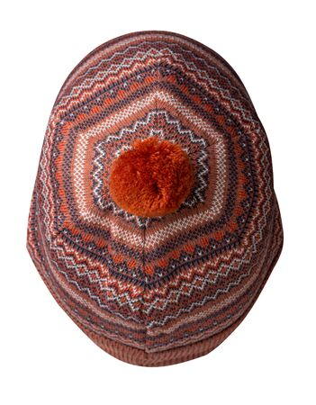 knitted red blue and white hat isolated on white background.hat with pompon top view . Imagens