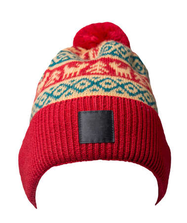 knitted red yellow blue hat isolated on white background.hat with pompon. Stock Photo
