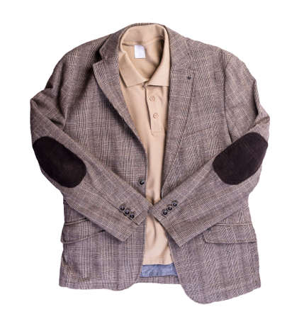 Brown jacket with buttons and beige polo shirt with a collar and buttons isolated on a white background. Casual style