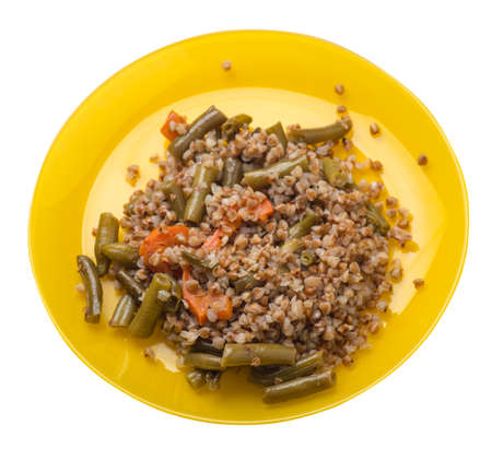 buckwheat with green beans with garlic and carrots isolated on white background. 免版税图像