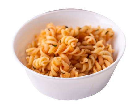 pasta on white plate isolated on white background. pasta in tomato sauce with dill. pasta top side view