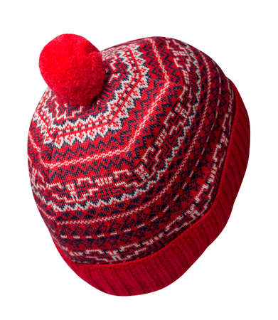 knitted red dark blue white hat isolated on white background.hat with pompon. Stock Photo