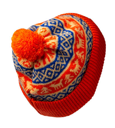 knitted orange blue yellow hat isolated on white background.hat with pompon.
