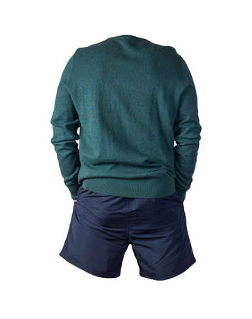 knitted turquoise sweater and dark blue shorts isolated on white background. fashionable clothes for every day