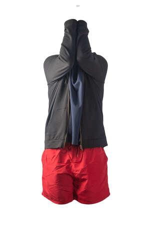 black sweatshirt with iron zipper hoodie, dark blue polo t-shirt and red sports shorts isolated on white background. casual sportswear