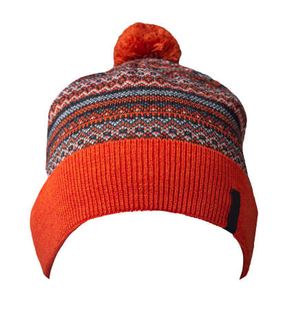 knitted red dark blue white hat isolated on white background.hat with pompon.