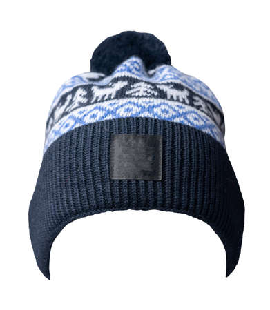 knitted dark blue white hat isolated on white background.hat with pompon.