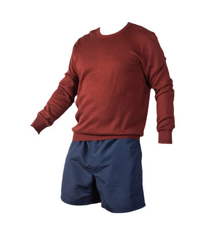 knitted burgundhe sweater and dark blue shorts isolated on white background. fashionable clothes for every day Stock Photo