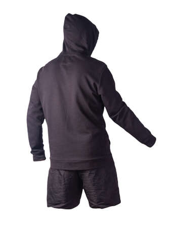black sweatshirt with an iron zipper with a hood and black sports shorts isolated on a white background. casual sportswear Stockfoto