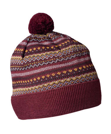 knitted burgundy yellow black white hat isolated on white background.hat with pompon. Stock Photo