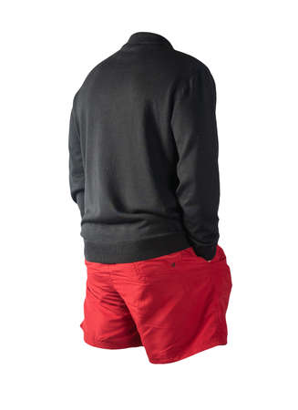 knitted black sweater and red shorts isolated on white background. fashionable clothes for every day