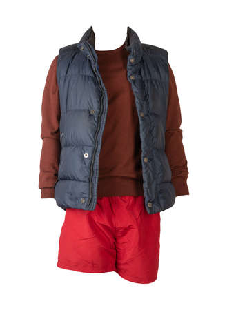 Dark blue sleeveless jacket, burgundy sweater and red sports shorts isolated on white background. clothes for every day Banco de Imagens