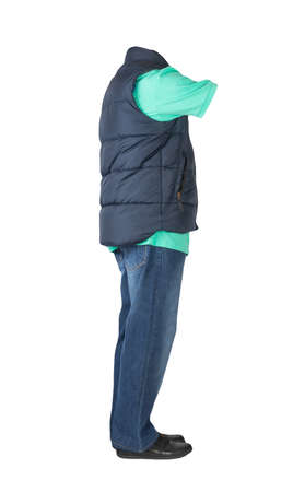 dark blue sleeveless jacket, dark blue jeans, green t-shirt with collar on buttons and black leather shoes isolated on white background