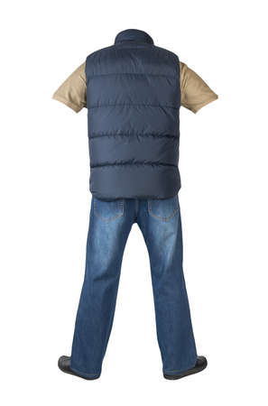 dark blue sleeveless jacket, dark blue jeans, beige t-shirt with collar on buttons and black leather shoes isolated on white background Banco de Imagens