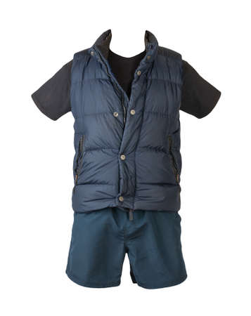 dark blue sleeveless jacket, t-shirt and sports shorts isolated on white background. Valid clothes for cool weather