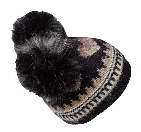 knitted black beige hat isolated on white background.hat with pompon. Stock Photo