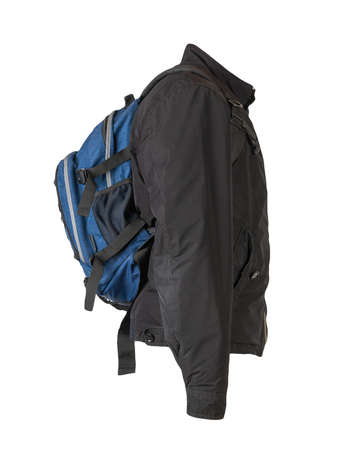 blue denim backpack dressed in black jacket isolated on a white background. rear view of a backpack and jacket