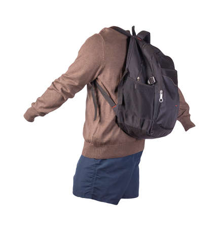 black backpack, dark blue shorts, brown sweater isolated on white background. casual wear 免版税图像