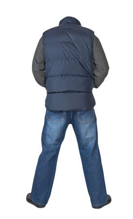dark blue sleeveless jacket, blue jeans, dark gray sweater and black leather shoes isolated on white background. Casual style