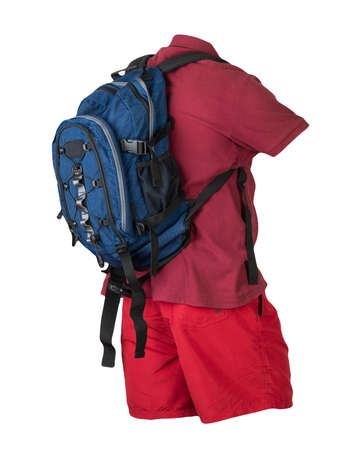denim blue backpack, red sports shorts, dark red shirt with a collar with buttons isolated on white foane. clothes for every day 免版税图像