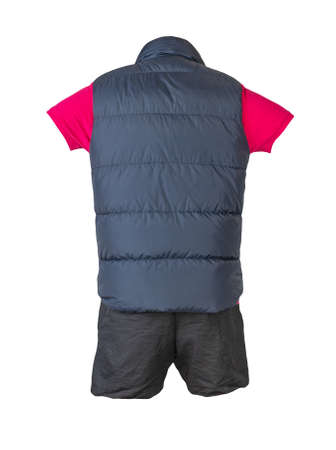 Dark blue sleeveless jacket, red t-shirt with collar on buttons and black sports shorts, isolated on white background. Current clothes for cool weather