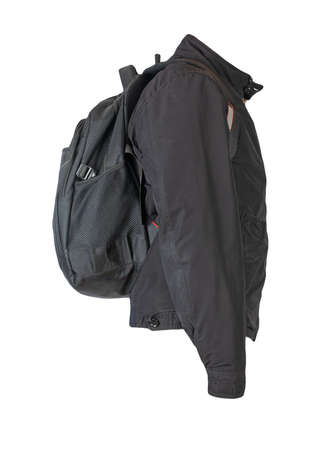black backpack dressed in black jacket isolated on a white background. rear view of a backpack and jacket 免版税图像