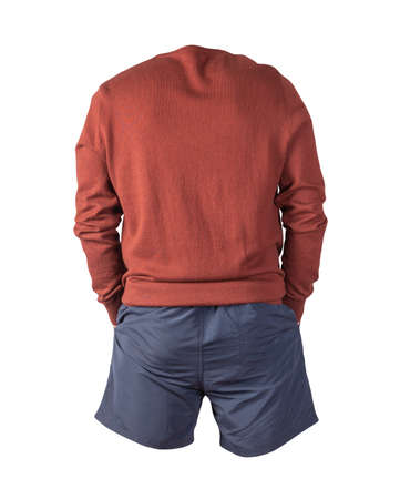knitted red sweater and dark blue shorts isolated on white background. fashionable clothes for every day