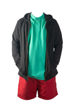 black sweatshirt with iron zipper hoodie, green t-shirt and red sports shorts isolated on white background. casual sportswear 免版税图像