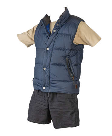 dark blue sleeveless jacket, beige t-shirt and black sports shorts isolated on white background. Valid clothes for cool weather 免版税图像