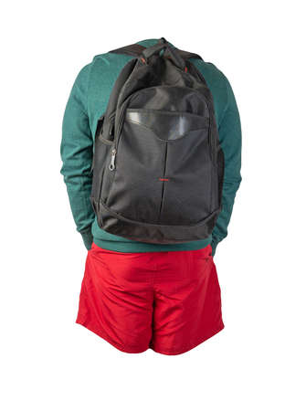 black backpack, red shorts, turquoise sweater isolated on white background. casual wear 免版税图像