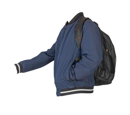 black backpack dressed in dark blue bomber jacket isolated on a white background. rear view of a backpack and jacket
