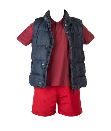 Dark blue sleeveless jacket, dark red t-shirt with collar on buttons and red sports shorts, isolated on white background. Current clothes for cool weather 免版税图像