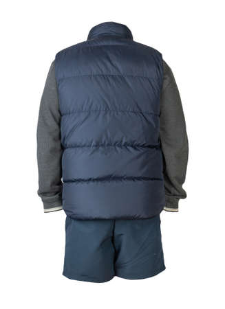 Dark blue sleeveless jacket, gray sweater and dark blue sports shorts isolated on white background. clothes for every day 免版税图像
