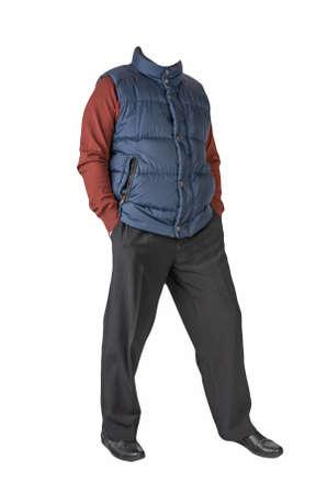 dark blue sleeveless jacket, black pants, dark red sweater and black leather shoes on white background 免版税图像