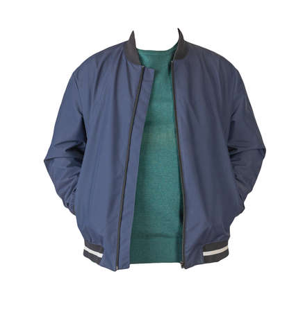 dark blue bomber jacket with hood and green sweater isolated on white background 免版税图像