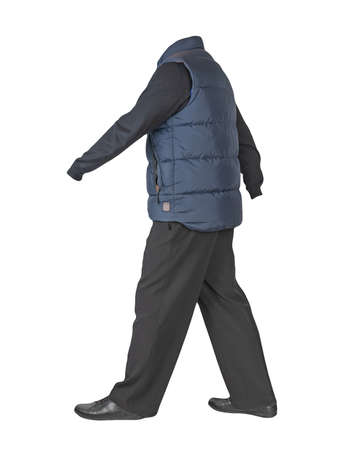 dark blue sleeveless jacket, black pants, black sweater and black leather shoes on white background 免版税图像