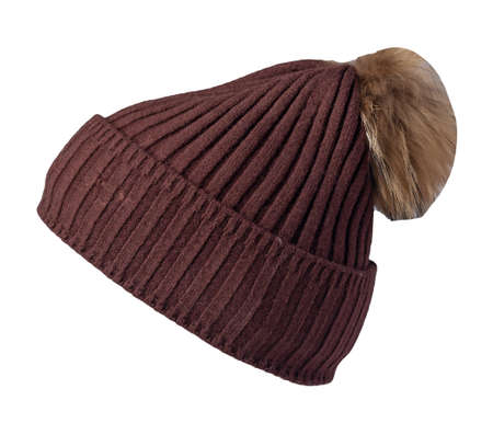 women's brown hat knitted with beige pompon isolated on white background. warm winter accessory 免版税图像