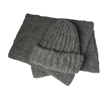 gray knitted hats and scarf isolated on a white background. winter accessories