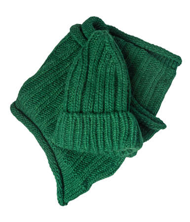 green knitted hats and scarf isolated on a white background. winter accessories 免版税图像