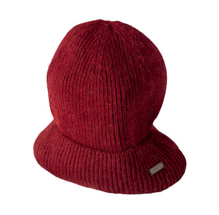 hat dark red knitted isolated on white background. warm winter accessory 免版税图像