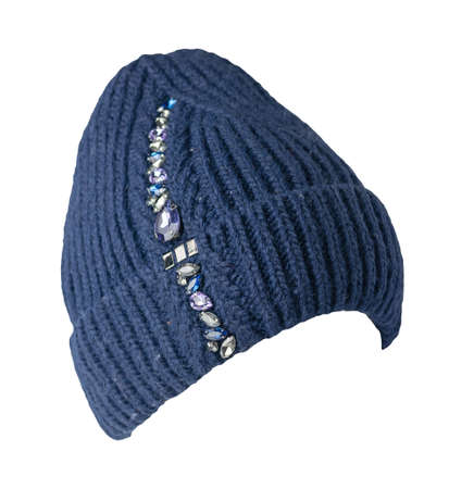 women's dark bue hat with rhinestones knitted isolated on white background. warm winter accessory 免版税图像