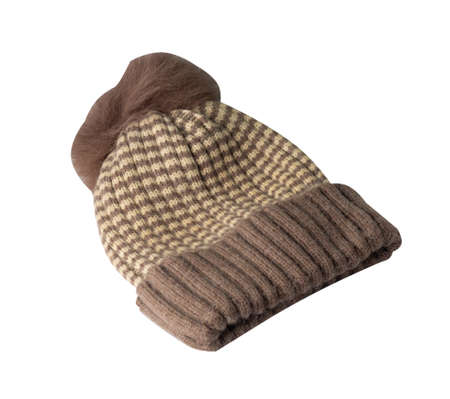 women's brown biege hat knitted with pompon isolated on white background. warm winter accessory