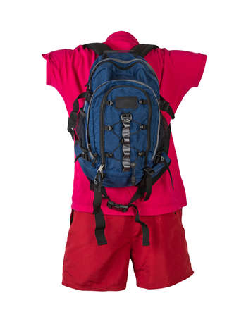denim blue backpack, red sports shorts, red shirt with a collar with buttons isolated on white foane. clothes for every day