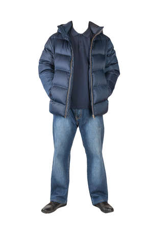 dark blue jeans, dark blue t-shirt with a collar on buttons, dark blue down jacket with hoodand and black leather shoes isolated on white background 免版税图像