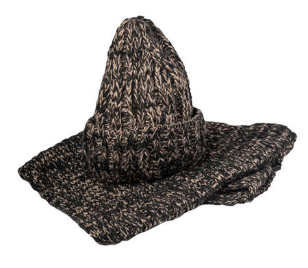 brown black knitted hats and scarf isolated on a white background. winter accessories